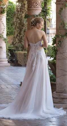 Style 4026: Organza adds softness and romance to this slim A-line wedding dress. Lace accents the bodice at the sweetheart neckline down to the hip. Finished with buttons at the zipper closure.