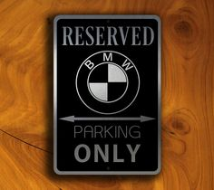 BMW Reserved Parking Sign http://www.classicmetalsigns.com/product/bmw-reserved-parking-sign/