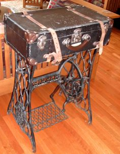 Sewing machine stand with vintage suitcase table