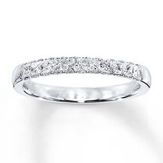 Shimmering princess-cut diamonds set in 14K white gold dazzle in this lovely band for her. The ring, perfect for a wedding or anniversary band, has a total diamond weight of 1/2 carat. Diamond Total Carat Weight may range from .45 - .57 carats.