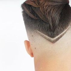 Thecombination oftwo hair trends, the fade and hair designs, is leading to all kinds of creative and new hairstyles for men. One of them stands out for it's simplicity and bold style. The V-shaped neckline shapes