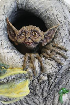 Love the long fingers! RavendarkCreations on Etsy created this expressive OOAK Knot-hole Fairy Goblin Wall Hanging.