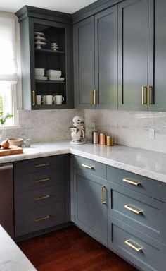 Remodeling Kitchen Cabinets dark gray cabinets and brass hardware Uplifting Kitchen Remodeling Choosing Your New Kitchen Cabinets Ideas. Delightful Kitchen Remodeling Choosing Your New Kitchen Cabinets Ideas. Large Kitchen Cabinets, Kitchen Cabinet Colors, Kitchen Redo, Home Decor Kitchen, Interior Design Kitchen, Island Kitchen, Kitchen Walls, Repainted Kitchen Cabinets, Kitchen Storage