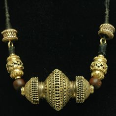 India ~ Gujarat.| 22k gold bead choker from the early 20th century | Large center filigree and granulated hollow gold bead.