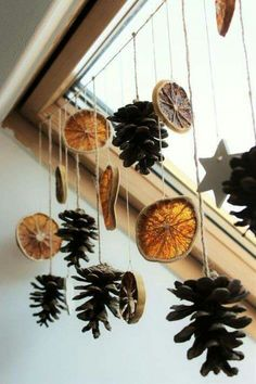 dried orange slices, several pine cones and star shapes, tied to a string and hanging from a ceiling window with wooden window pane Christmas decorations ▷ 1001 + Ideas for DIY Christmas Gifts and Festive Decoration Diy Christmas Gifts, Winter Christmas, Christmas 2019, Holiday Crafts, Christmas Ornaments, Xmas, Yule Crafts, Simple Christmas, Elegant Christmas