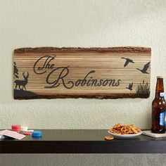 Personalize your home with this decorative Hunter's Hideaway Personalized Basswood Plank