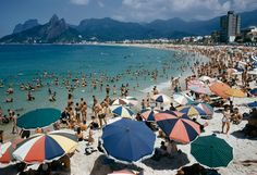 Umbrellas and swimmers dot Arpoador Beach in Rio de Janiero, Brazil, March 1955.Photograph by Charles Allmon, National Geographic