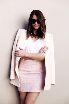 light pink skirt and blazer with a white top.