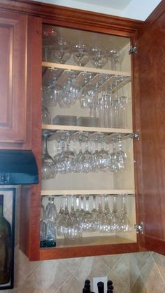 Cabinet storage solution for all the different glasses.  Pinned from - Road to the Ravenna: DIY Wine Glass Storage
