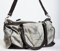 Blue and white distressed bag with leather accents