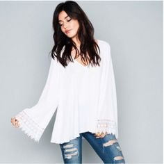 MAL TOP ~ WHITE CRISP White Crisp is a pleasantly fresh addition to any closet. Looks great as a statement or paired with bright and wild prints! Throw on all your chunky jewels and you are ready to go! Show Me Your MuMu Tops Blouses