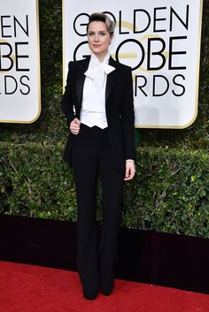 This 2017 image shows actress Evan Rachel Wood dressed in a mannish suit at the Golden Globe Awards. She is displaying mannish styles through the use of tightly fitted trousers, a suit jacket and a cravat around her neck. Source: Popsugar