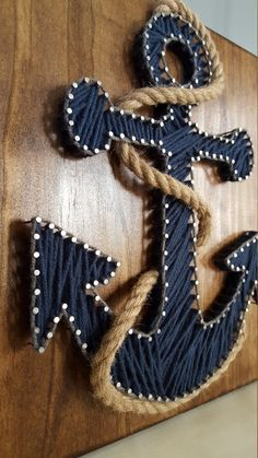 ~Cape cod blue anchor string art with rope accent! ~Handmade ~Attached sawtooth wall hanger ~Great nautical decor for baby's nursery, your boat, a great gift for the nautical fan too! Chestnut colored wood ~Other color options available in Anchor String Art, String Art Diy, Anchor Art, Nautical Anchor, Cape Cod, String Art Templates, String Art Patterns, String Art Tutorials, Doily Patterns