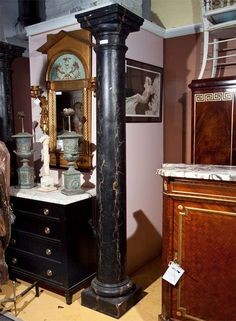 For Sale on 1stDibs - Attractive pair of very large faux marble painted columns, black with beige veins. Professionally painted to appear as marble. Removed from a courtyard Marble Pillar, Marble Painting, Black Cement, Columns, Pedestal, Liquor Cabinet, Indoor, Beige, Storage