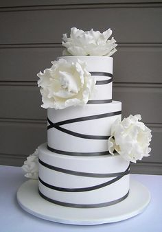 Simple black and white wedding cake with gorgeous flowers.
