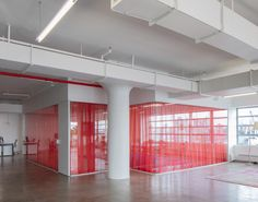 Red drapes partition stark white HUSH offices in Brooklyn - Dr Wongs Emporium of Tings - Curtain Brooklyn, New York Office, Separating Rooms, May Designs, Red Curtains, Minimal Decor, Lounge Areas, Plan Design, Architectural Elements