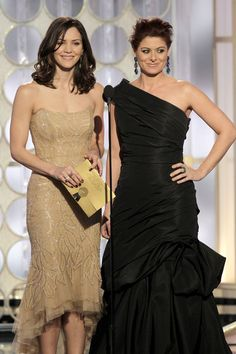 Presenters Katharine McPhee, Debra Messing on stage during the 69th Annual Golden Globe Awards held at the Beverly Hilton Hotel on January 15, 2012 -- Photo by: Paul Drinkwater/NBC