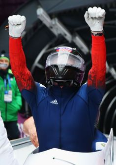 Pilot Alexander Zubkov of Russia team 1 celebrates winning gold during the Men's Two-Man Bobsleigh (c) Getty Images Bobsleigh, Two Men, Bicycle Helmet, Football Helmets, Olympics, Pilot, Russia, Athlete, Celebrities