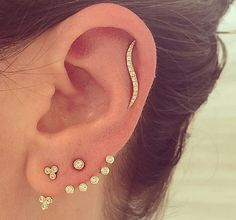 EFC Double Diamond Bezel Trio Ear Jacket seen with Multi Bezel Diamond Ear Jacket and Diamond Wave Ear Cuff