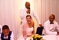 Bride laughing during the speeches.Traditional wedding photography at Q Vardis Uxbridge, London.