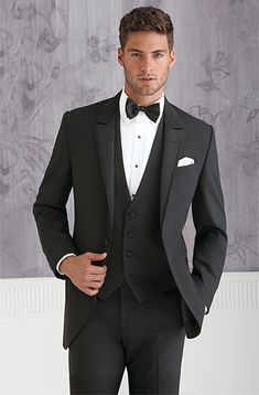 Coppley 9718 Black, one-button vented tuxedo with self-edged, floor-level peak lapel. Slim fit. Sizes: Boys' 2 to men's 66 Trousers: Flat front 0100 Shirt: White turned down collar shirt WW Tie: Black satin bow tie 59 Vest: Black satin vest F244 Pocket Square: White synergy pocket square P548