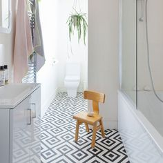 Modern monochrome bathroom with geometric vinyl floor tiles The best bathroom design ideas. Create your perfect bathroom whatever your style, budget and room size. We've got that covered, too Vinyl Flooring Bathroom, Bathroom Vinyl, Vinyl Tiles, Bathroom Floor Tiles, Kitchen Flooring, Bathroom Interior, Tile Floor, Downstairs Bathroom, Small Bathroom