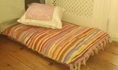 This is a great idea - two inexpensive rugs, maybe from IKEA, stuffed with old blankets to make a big floor cushion