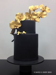 Black and gold cake for right side of Wedding Showcase sweet dessert table.  Hand formed and painted orchid branch detailing.  Fondant and gumpaste.  Thanks Karen!