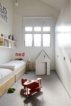 narrow w/ 2 beds longways, wall of cabinets & long shelf