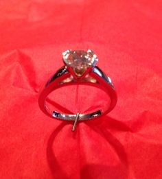 .71ct G color SI1 clarity GIA graded diamond set in 14k quit gold cathedral mounting in a half bezel head.