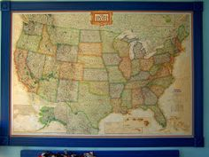 """Pinner says """"I also put cork contact paper behind the map for pinning places we've been. And cheated further on the frame by hanging each piece with command strips. Looks great and ~$35 versus the $150 on skymall!"""" Maybe fun to do one of the whole world!"""
