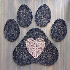 This paw print with a heart in the center was originally created as a custom order for a couple who met at a dog park and its too sweet not to share! This board adds the perfect amount of cheer to any dog lovers space. This listing is for a made to order string art paw print and