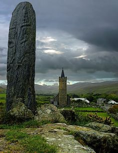 An ancient Celtic stone and much more recent church in the Irish countryside