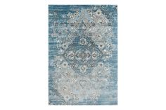 """4620 Distressed Blue 5'2"""" x 7'2"""" Area Rug at Amazon, $90 Available in two other colors (gray as well as black), I love the subtle fading on this stain-resistant rug."""