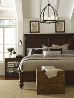 Illuminate your rustic, industrial chic bedroom with a statement chandelier above the bed. #masterbedroom