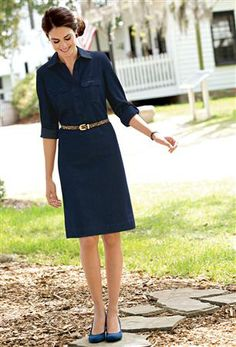 Shirt dress- slight a-line skirt, simple collar, rolled sleeves with tabs and buttons, small chest pockets have thin flaps.