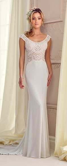 Jersey and embroidery fit and flare gown with scalloped slight cap sleeves, front and back scooped necklines, hand-beaded and embroidered illusion bodice, covered buttons down embroidered illusion back, chapel length train.
