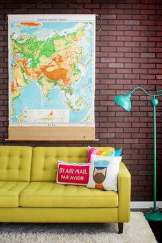 A statement floor lamp, chartreuse sofa