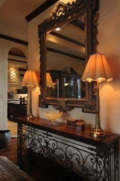 Wrought Iron Foyer Table The ornateness of this would have to be matched throughout Tuscan Style Homes, Tuscan House, Foyer Decorating, Tuscan Decorating, Luxury Mediterranean Homes, Mediterranean Decor, Tuscany Decor, World Decor, Colorful Decor