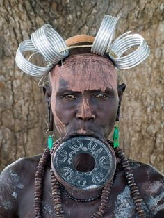The Mursi tribe are an African tribe from the isolated Omo valley in Southern Ethiopia near the border with Sudan. There are an estimated people in the We Are The World, People Of The World, Anatomy Sketch, Nam June Paik, Mursi Tribe, Tribal People, Tribal Women, Types Of Piercings, African Tribes
