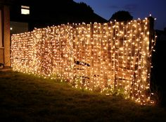curtain lights on fence for night-time garden party or outside wedding! Curtain Lights, Fairy Light Curtain, Festa Party, Garden Fencing, Garden Trellis, Summer Garden, Outdoor Lighting, Pathway Lighting, Christmas Lights