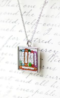 Book jewelry -- personalized necklace with your 7 favorite titles {www.sarahlambertcook.etsy.com}