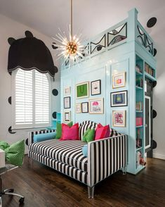 Inspired by Kate Spade, this tween girl's bedroom uses a chic, black and white color palette with light blue, hot pink and bright green accents to complement the design. The light blue, lofted bed doubles as a bookshelf to maximize space.