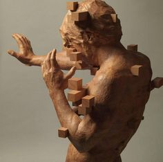 In a clash of digital and analogue, artist Hsu Tung Han carves figurative sculptures from wood that appear to be dissolving into fields of pixels. The Taiwanese artist views the carved figures of men and women as puzzles, planning for each configuration through a series of drawings and clay models.