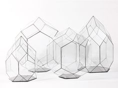 The Cathedral Terrariums feature a beautiful, faceted design which create a naturalistic housing for natural scenes. Minimalist construction makes these gem-like glass houses dream homes for the imagination. Made from recycled glass, they turn the tired terrarium into a work of natural art.
