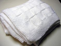 """White knit blocks afghan (not sure I'd want to """"sew"""" all the blocks together though)"""