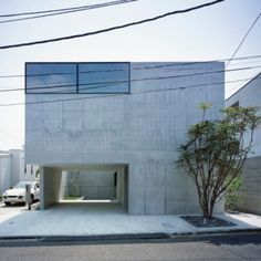 www.terenceproperties.com www.terenceyam.net  Apollo Architects creates spaces for artwork and cars in raw concrete Grigio house