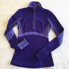 Lululemon Half Zip Jacket Lululemon jacket with lots of extras. Little zipper hood at the zip top. Tall collar. Cuffs that fold down as mittens. Thumb holds. Cute zippered back pocket.  Mint condition. lululemon athletica Jackets & Coats