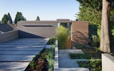 18 Inspirational Examples Of Modern Garage Doors // Blending into the rest of the exterior, this garage door is only made obvious by the driveway leading up to it.