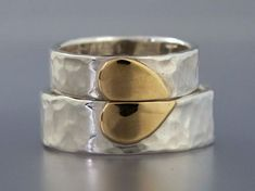Heart of Gold Wedding Band Set in 14k Gold and Sterling Silver - We Hold One Heart... I kind of like this idea